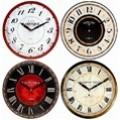 Reloj de pared 28 cm. decorado